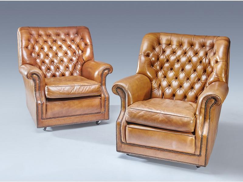paire de fauteuils confortables en cuir havane. Black Bedroom Furniture Sets. Home Design Ideas